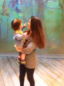 Mama Shana Cooper, Director, and son Jonah, 15 months, exploring the projections on stage during dinner break of rehearsal for The Nether, Wooly Mammoth Theatre Company.